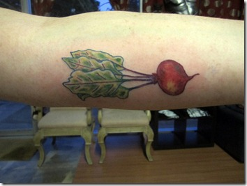beet tattoo arm