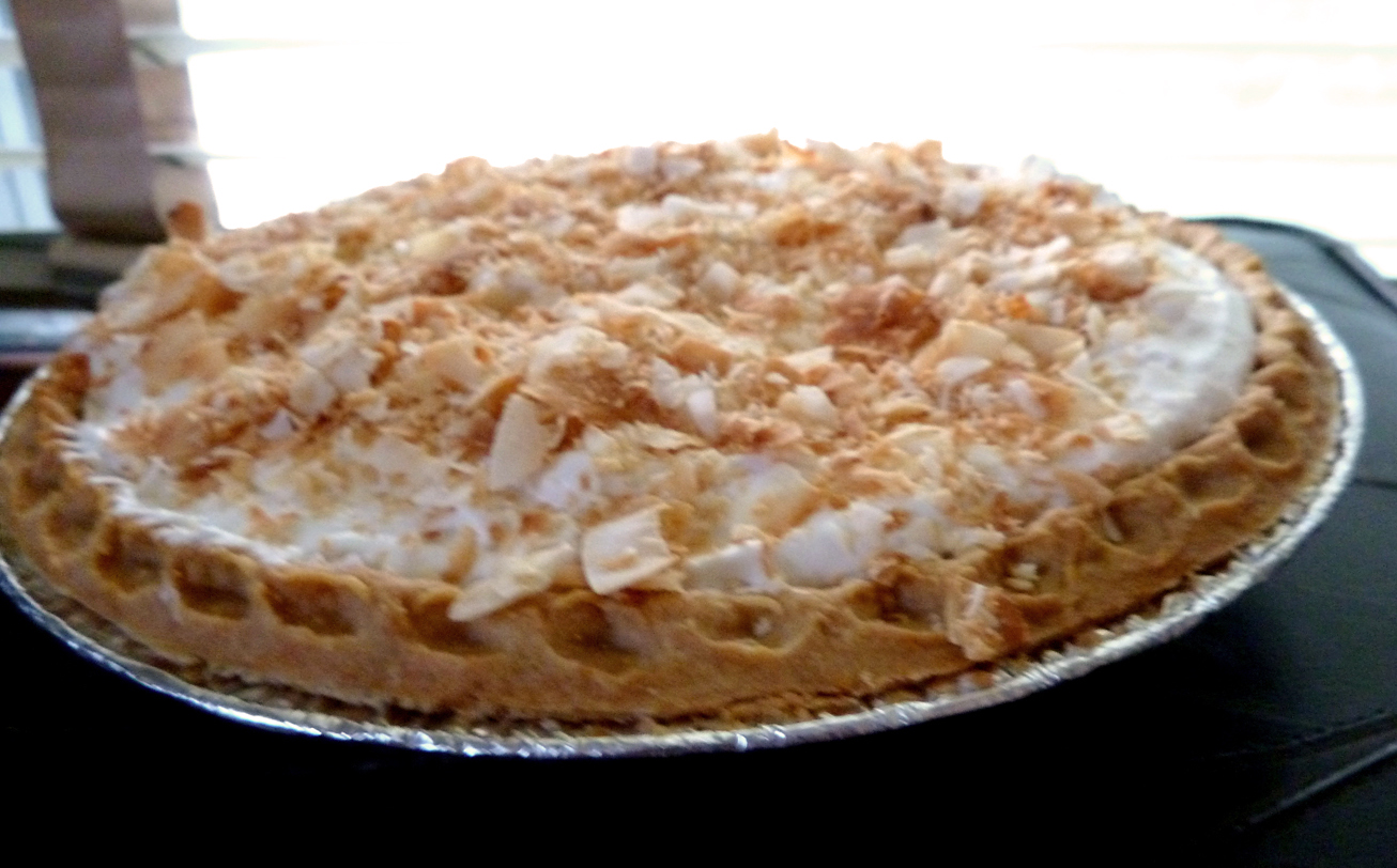 Vegan Coconut Cream Pie with coconut whipped cream and topped with toasted coconut flakes. Also: coconut.